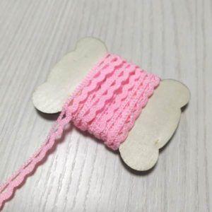 puntilla bolillos rosa chicle