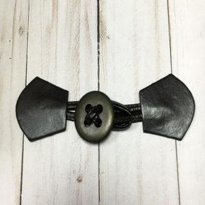 Cierre trenca botón de color marrón