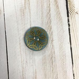 Botón azul con detalles dorados