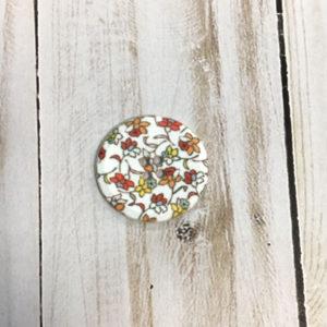 Botón blanco flores