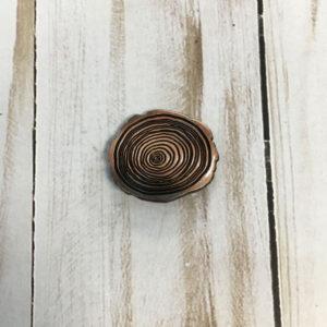 Botón flor color cobre