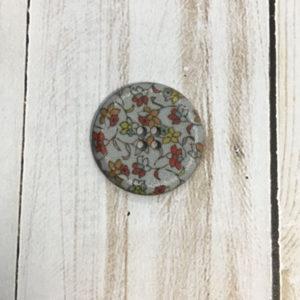 Botón gris flores