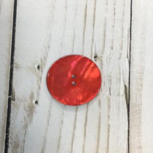 Botón nacarado rojo