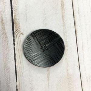 Botón con textura negro y gris