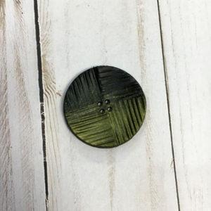 Botón con textura negro y verde