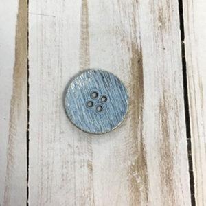 Botón con textura azul brillante