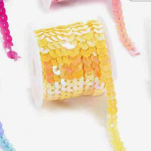 Tira con lentejuelas color amarillo